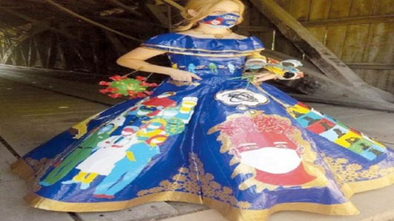 """مراهقة تصمّم فستان """"كورونا"""" لتعبّر عن معاناة العالم من الوباء"""